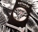Mothman Pin Front card against shirt resized 600